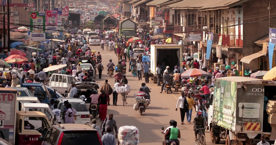 Kampala, Uganda - February 13 , 2020 : Heavy traffic and people in the center of Kampala.Kampala is the capital city of Uganda in Africa.