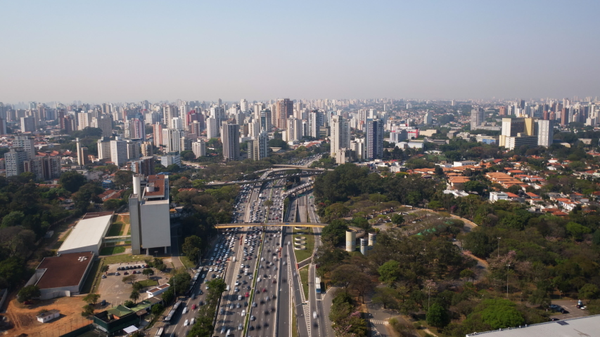 4K UHD Hyperlapse aerial drone footage of motorway 23 de maio in Sao Paulo, Brazil High view looking down on busy traffic at junction in sunny day. Long exposure city life and transportation.