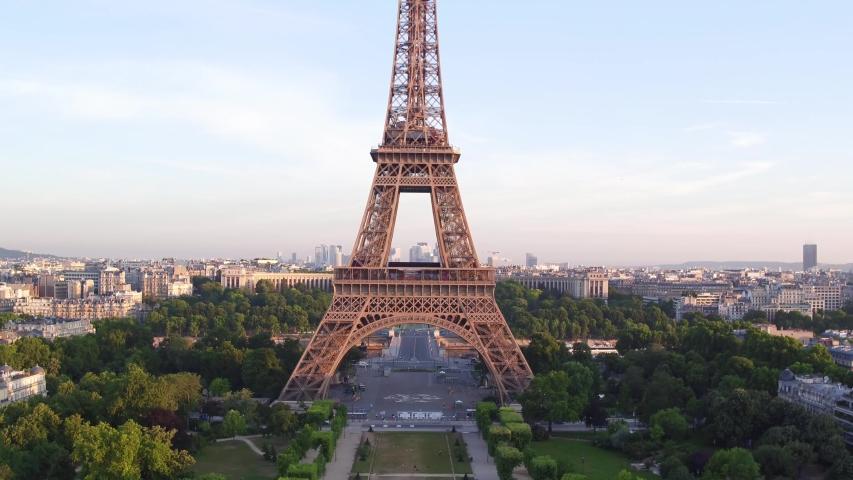 France, Paris, Tour Eiffel (Eiffel tower) champ de mars with La Defense and Trocadero background, at sunrise . 4k High Quality shot, aerial drone view.