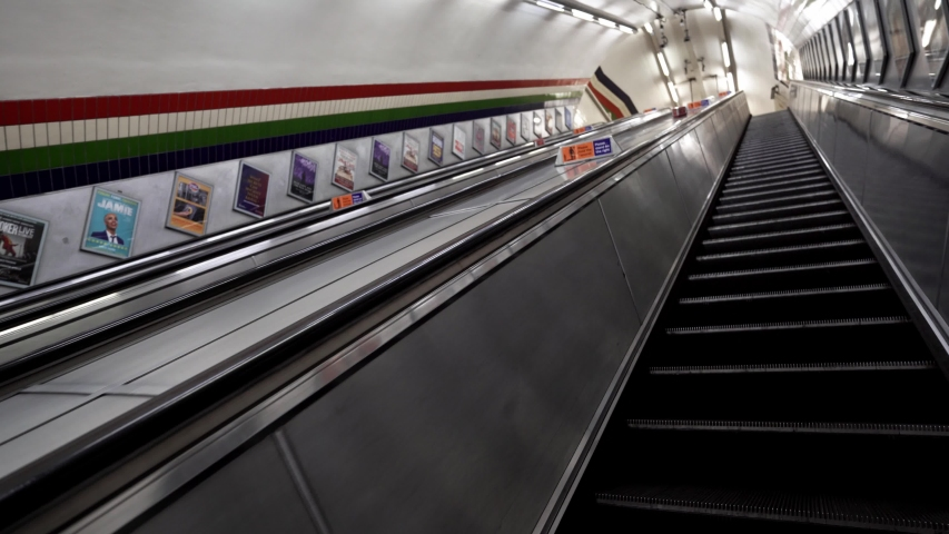 London / UK - 05/04/2020:  London's busiest area, Piccadilly Circus station, popular tourist destination empty as people self isolate during COVID-19 coronavirus pandemic. Escalator. Stairs. Going up