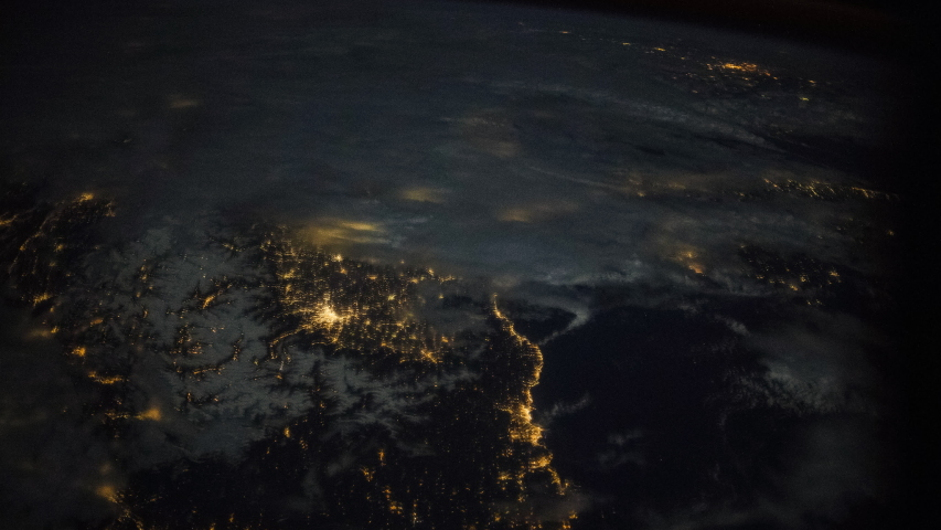 ISS Time-lapse Video of Earth seen from the International Space Station with dark sky and city lights at night over Europe, Time Lapse 4K. Images courtesy of NASA. Pan down motion timelapse