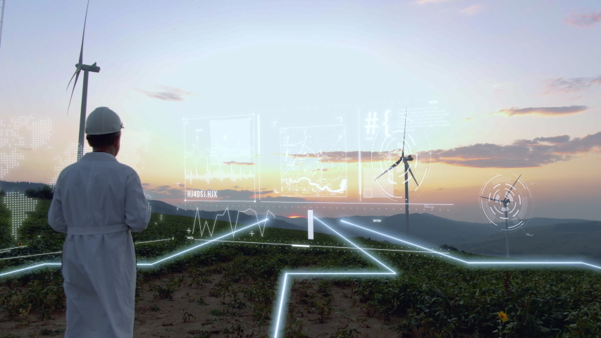 Aerial view of engineer using hologram panel to control wind turbine energy flow. Flying over future technology lines field. Renewable Alternative Green Industrial Power. Augmented reality concept Royalty-Free Stock Footage #1051926154