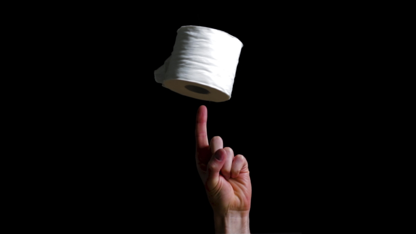 Toilet paper roll spinning on finger satirical sacred object during pandemic. Stocking up on toilet paper panic buying in bulk. Home quarantine concept with symbol of hygiene. Toilet paper.  | Shutterstock HD Video #1051929262