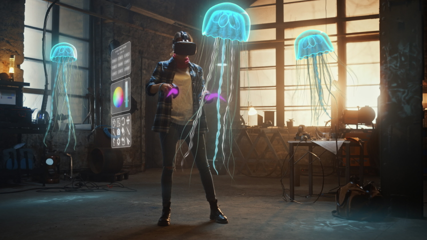 Female Artist Wearing Augmented Reality Headset Working on Abstract 3D Jellyfish Sculpture with Joysticks, Uses Gestures To Create High-Tech Internet Multimedia Concept Art.3D Animation Special Effect Royalty-Free Stock Footage #1051965439