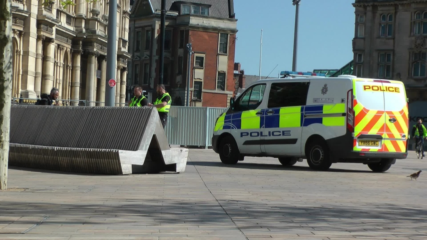 UK Police patrolling with a van in a city centre in lock down due to corona virus, covid 19 pandemic. Stay at home, protect NHS, save lives. Filmed Yorkshire, Engalnd, UK. 06/05/2020   Shutterstock HD Video #1051971715
