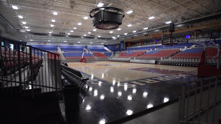 Pittsburgh, Pennsylvania / USA - March 20, 2020: 2020 Coronavirus Covid 19 Disease Closed Empty Basketball Arena Gym Stadium University College Campus 4K