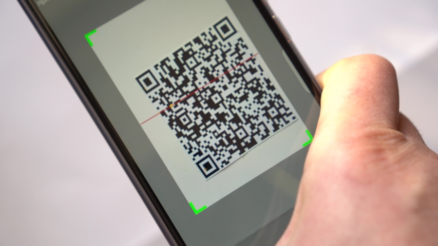 QR Code Scanning and reader app with smartphone. Using QR code for payment, commercial tracking, ticketing, product and loyalty marketing and in-store product labeling, exchanging information Royalty-Free Stock Footage #1051985434