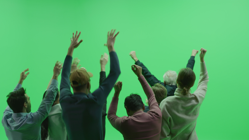 Green Screen Chroma Key Studio: Diverse Crowd of Fans Cheering, Screaming, Jumping, Clapping and Applauding with Hands in the Air at the Public Sport Event, Concert, Festival, Party. Back View Medium