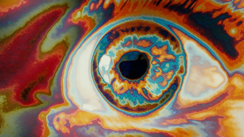 Hypnotic Eye Approaching Psychedelic Seamless Loop. Extreme close up of an wide opened eye in a psychedelic effect. Loop Ready