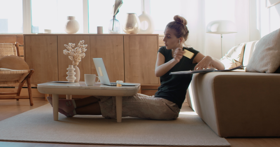 Caucasian female working from home, having a video work call, making notes. Stay home, quarantine remote work. Shot on RED Dragon | Shutterstock HD Video #1052014414