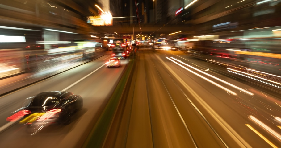 Time lapse of busy night traffic in city. Hong Kong. 4K. | Shutterstock HD Video #1052069683