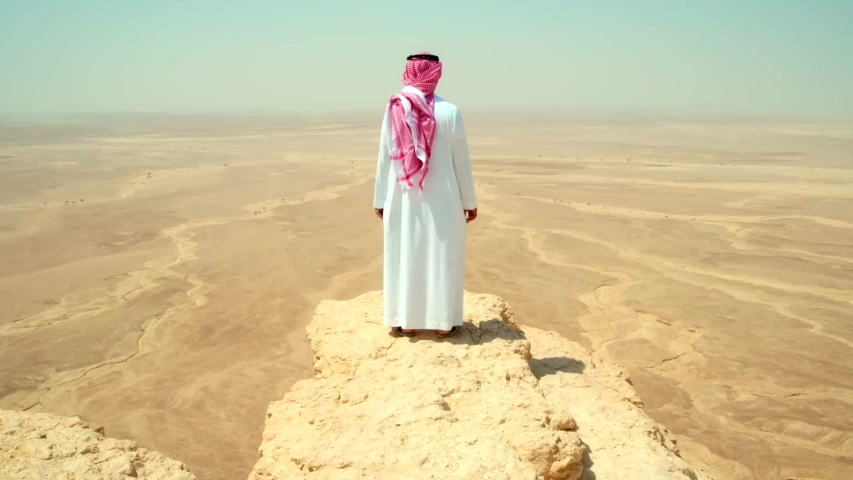 Arabian Desert / Saudi Arabia 07.09.2017         footage of men looking on Arabian Desert