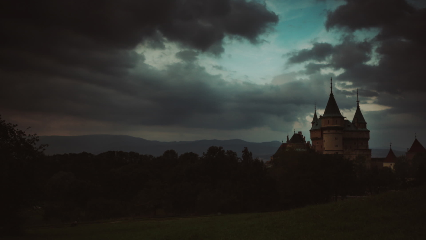 Time-lapse footage of clouds moving along evening sky with Bojnice castle in Slovakia in background   Shutterstock HD Video #1052087389