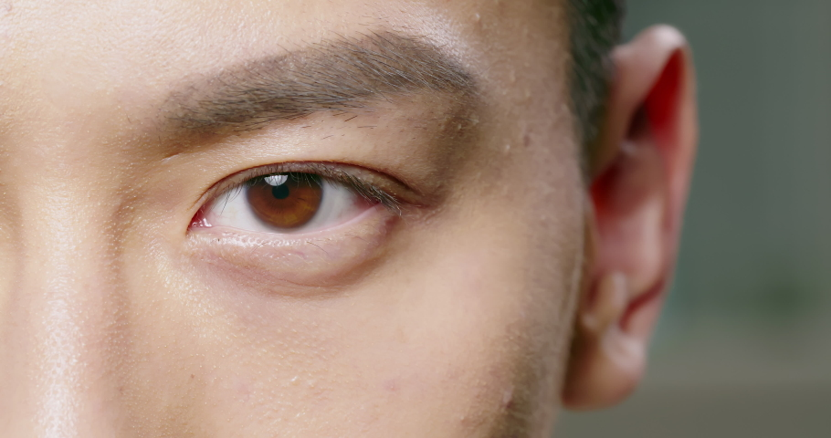 slow motion of male eye close up from asian young man half face Royalty-Free Stock Footage #1052136667