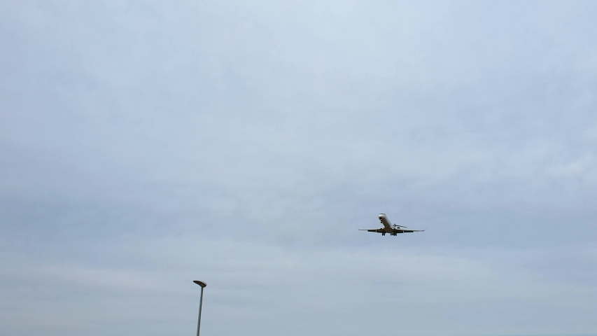 Fly by close shot SAS airplane landing in Copenhagen Airport grey sky