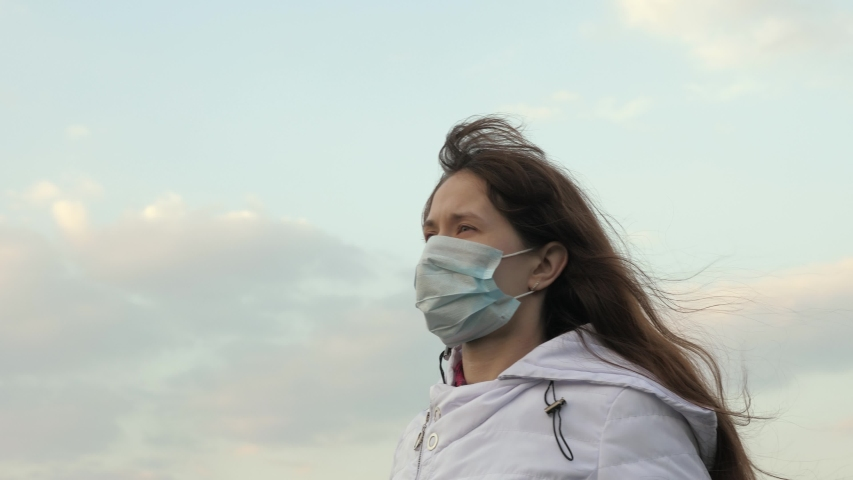 Concept health and safety, N1H1 coronavirus, virus protection. Protection against viruses and bacteria. woman tourist wearing protective mask on the street. Pandemic Coronavirus. | Shutterstock HD Video #1052162251
