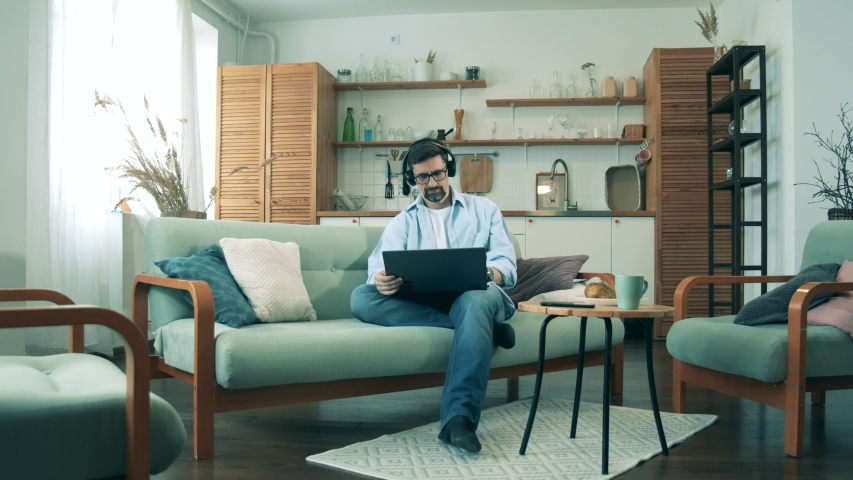 A man with a laptop is working from home during quarantine | Shutterstock HD Video #1052163895