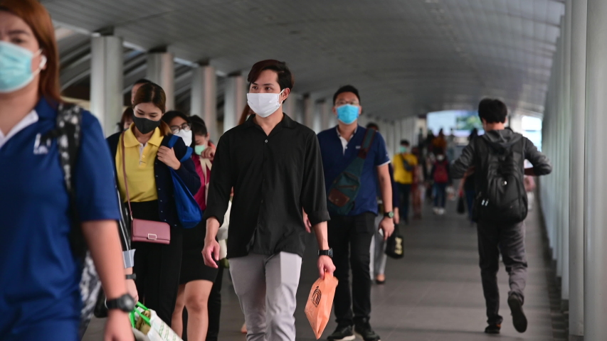 4K Crowded asian people wear face mask walking in pedestrian walkway | Shutterstock HD Video #1052168143