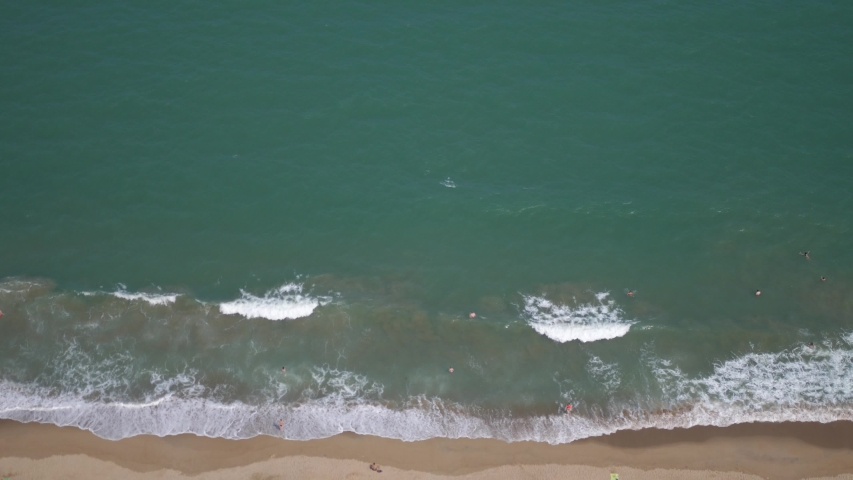 Aerial view of sand beach. Top view sea waves. slow motion. | Shutterstock HD Video #1052208508
