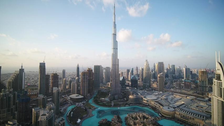 Dubai, United Arab Emirates - 12/31/2019 : Pull back shot of the magnificent Architecture of Dubai, Burj Khalifa, drone wide shot.
