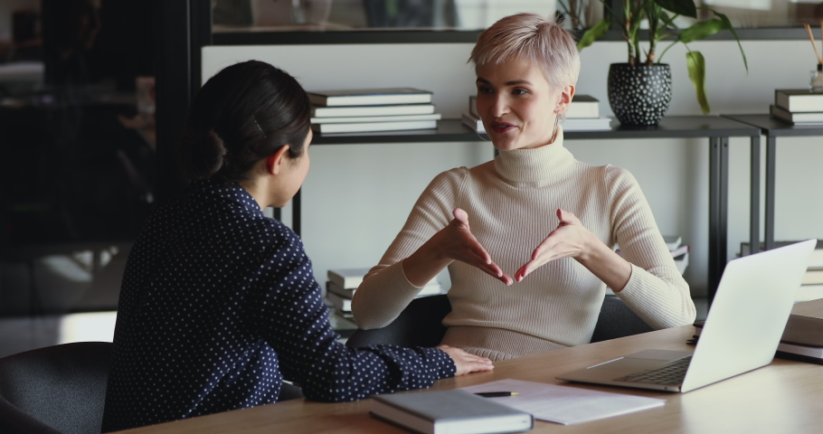 Confident professional female mentor training employee in office. Serious businesswoman manager talking to client, consulting customer explaining insurance benefits. Coaching, business advice concept Royalty-Free Stock Footage #1052221231