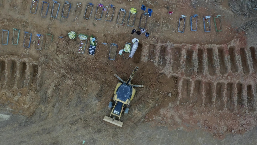 Manaus, Amazonas, Brasil - 05/08/2020 - drone footage of poor people being buried in mass graves due to the excessive number of deaths by Covid-19 at the Nossa Senhora Aparecida cemetery