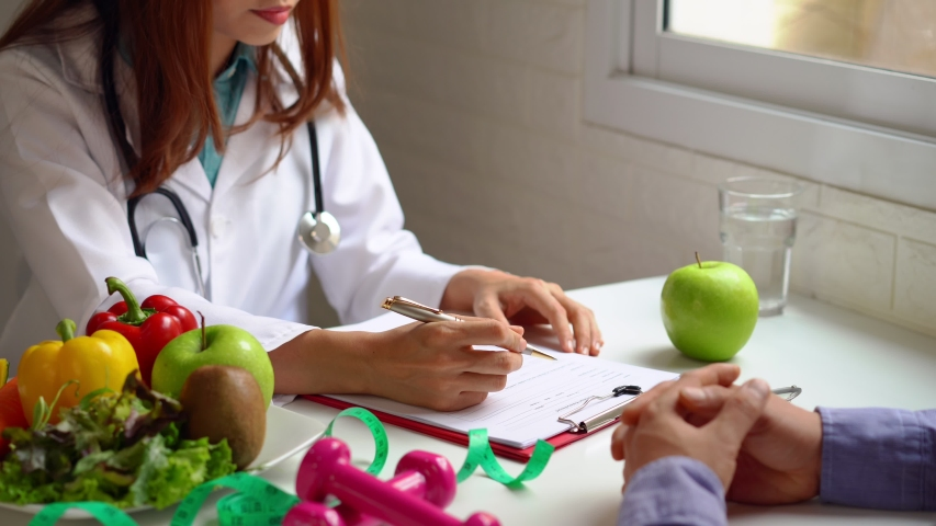 Nutritionist giving consultation to patient with healthy fruit and vegetable, Right nutrition and diet concept Royalty-Free Stock Footage #1052246740