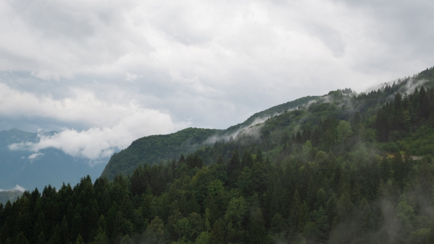OVARO, UDINE, ITALY - AUGUST 13, 2019 - Time lapse of a cloudy mountain, on August 13, 2019, at Muina, a fraction of Ovaro. | Shutterstock HD Video #1052273260