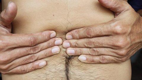 Close up men feel stomach ache, symptom of gastritis, indigestion