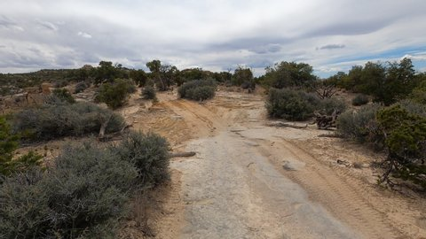 Off road trail 4x4 recreational ride desert Utah POV fast motion. San Rafael Swell geologic landscape south Utah. Valleys, canyons, gorges, mesas and mountains. Hikers, backpackers, off road recreatio