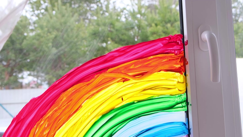 4k. large rainbow pattern on window during Covid-19 quarantine at home. Stay at home social media campaign for coronavirus prevention, let's all be well, hope. Chase the rainbow. | Shutterstock HD Video #1052292064