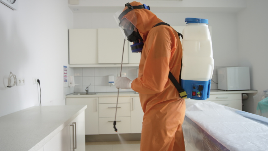 Frontline Coronavirus Worker in Hazmat Suit Disinfecting Operating Theater from COVID-19 | Shutterstock HD Video #1052307940