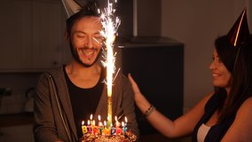 4K: Birthday Cake - A Man and Woman celebrating at the party. Stock Video Clip Footage