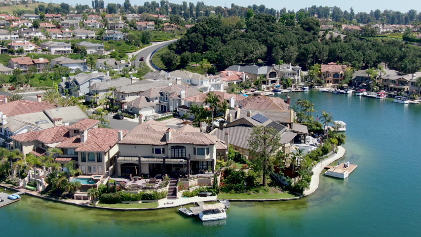 Aerial view of Lake Mission Viejo, with recreational facilities, surrounded by private residential and condominium communities. Orange County, California, USA Royalty-Free Stock Footage #1052319910