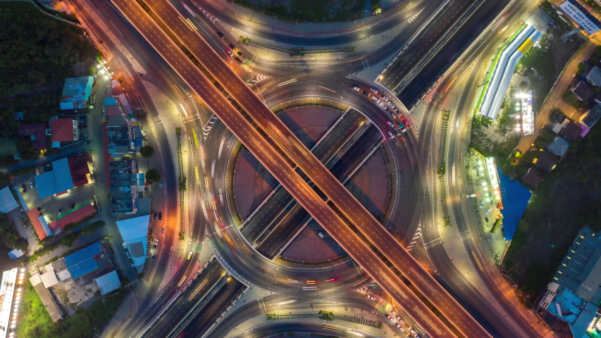 Time lapse Aerial view and top view of traffic on city streets in Bangkok , Thailand. Expressway with car lots. Beautiful roundabout road in the city center. | Shutterstock HD Video #1052328904