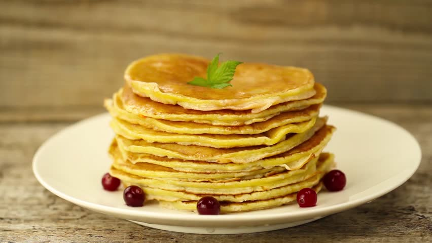 honey is poured on a stack of pancakes on wooden background. Breakfast #10523471