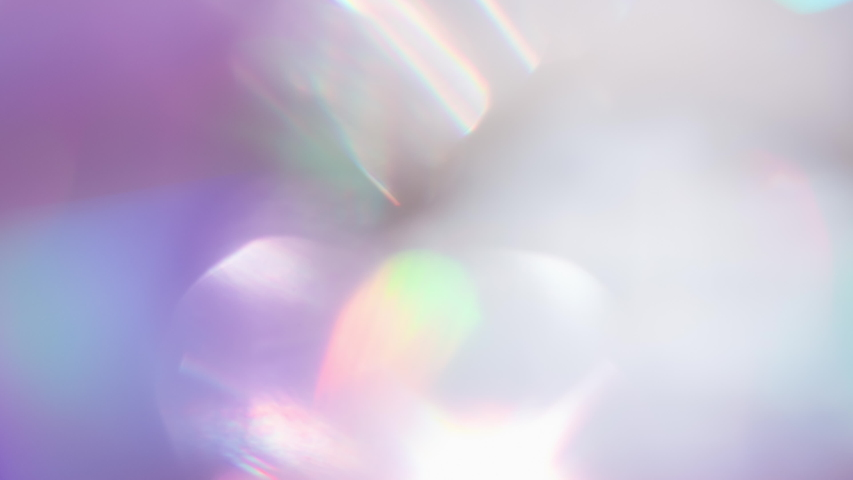 Optical Refraction in Violet Tones. Loop. The light passes through the facets of a slowly rotating diamond and creates repetitive sparkling highlights and rainbow colors | Shutterstock HD Video #1052369881