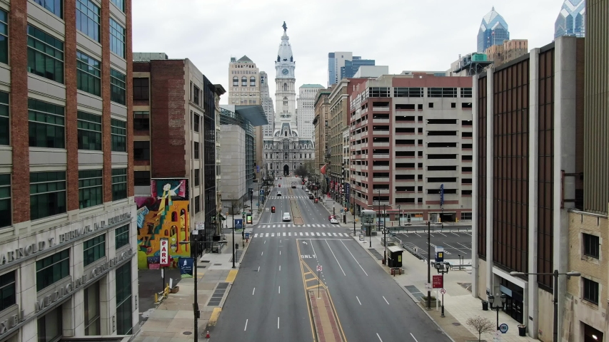 Philadelphia , PA / United States - 04 05 2020: Broad Street in Philadelphia City Hall aerial footage, covid quarantine shutdown shelter in place, coronavirus stay at home order, no people or traffic,