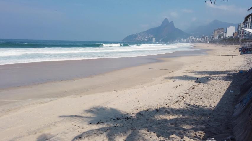 Empty ipanema beach during the coronavirus pandemic in Rio de Janeiro. | Shutterstock HD Video #1052426815
