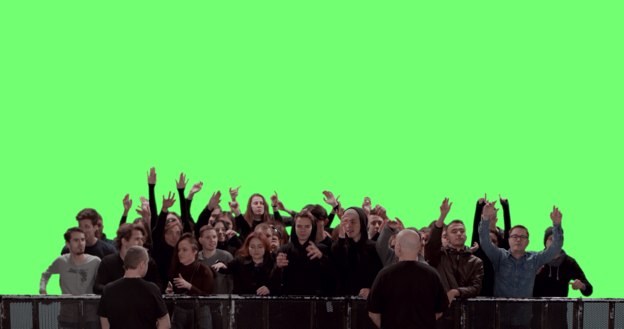 GREEN SCREEN CHROMA KEY Model released, Front view of huge crowd dancing and cheering at a concert or a show behind control barrier. Shot on RED Helium 8K Prores 4444 | Shutterstock HD Video #1052433784