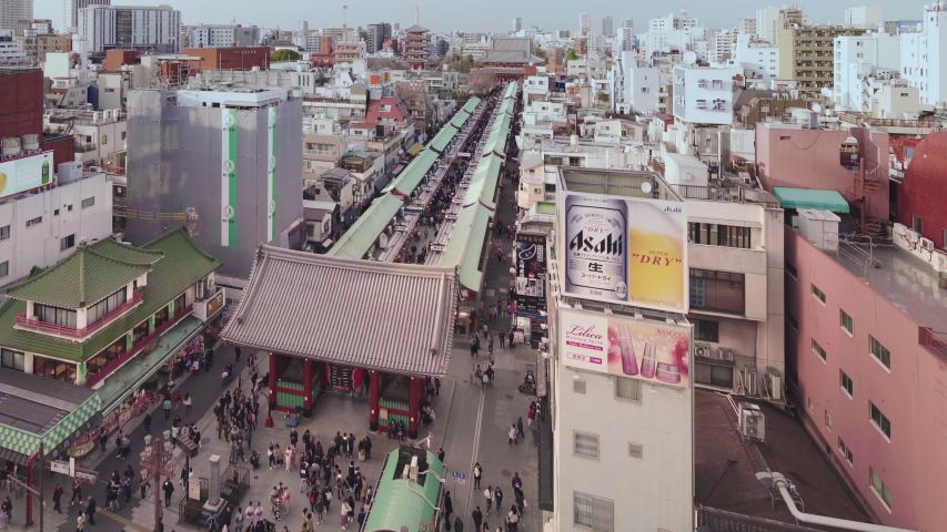 Tokyo, japan - march 18 2020: Tilt up video of  aerial view of crowd walking in the Nakamise shopping street of Sensoji temple leading to Kaminarimon gate in Asakusa. | Shutterstock HD Video #1052455444