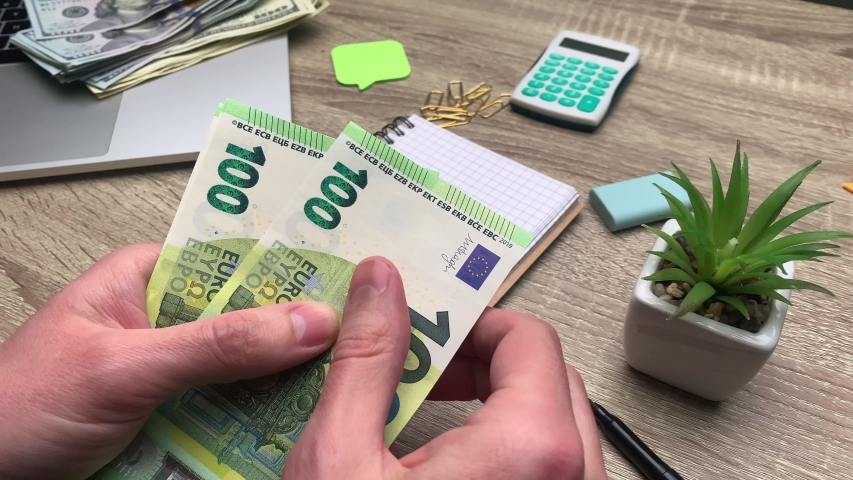 Concept of savings, man counts 100 euro banknote to start his own business | Shutterstock HD Video #1052488168