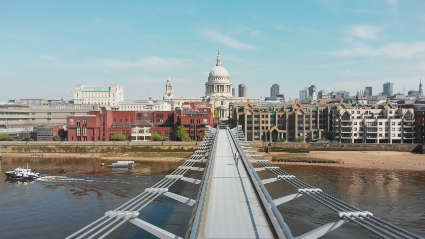 Drone shot Millenium bridge and St. Paul's Cathedral, almost nobody - 4K | Shutterstock HD Video #1052509504