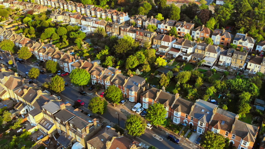 London victorian Suburb, aerial shot, golden hour, beautiful green area 4K
