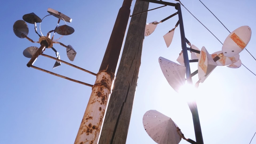 Old Rusty Wind Spinner against the Sun. Zoom In. Royalty-Free Stock Footage #1052522569