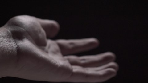 Hands moving in light and shadow