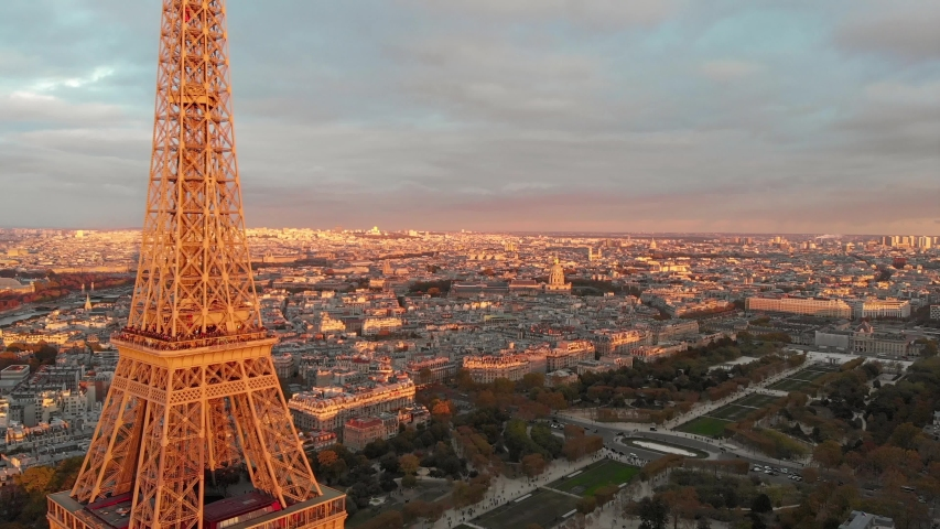 Aerial close up view of Paris Eiffel Tower Tour de Eiffel and panoramic view over Seine River and Paris city attractions at sunset    Shutterstock HD Video #1052549960