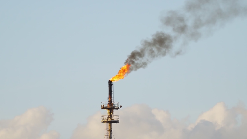 Footage B Roll A Fire on flare stack at refinery oil and gas central processing platform while burning toxic and release over pressure. gas flare at an oil refinery factory industrial. footage b roll. Royalty-Free Stock Footage #1052554442
