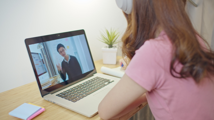 Asian woman, university college student using laptop computer study online at home. Male teacher remote teaching on internet. E-learning new normal lifestyle or coronavirus quarantine lockdown concept Royalty-Free Stock Footage #1052584292