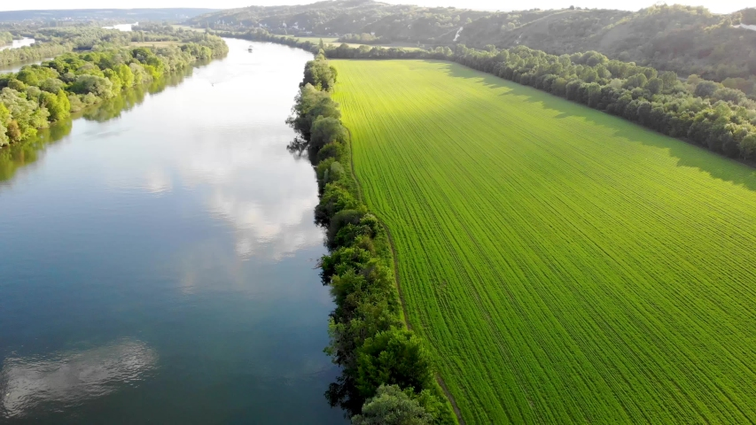 Scenic aerial view of the Seine river and green fields in French countryside. Val d'Oise department, Ile-de-France, Northern France | Shutterstock HD Video #1052621807